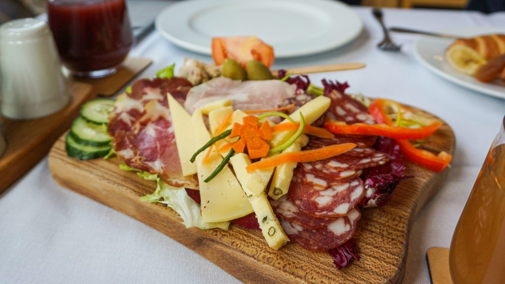 A cheese and meat platter at the breakfast of Villa Triglav Hotel
