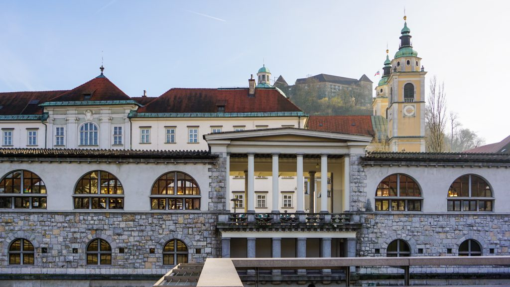 The Plečnik's Arcade with background the Cathedral and the Castle in Ljubljana