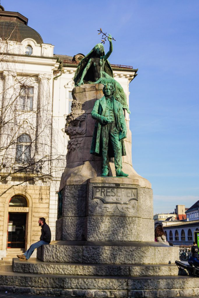 A statue of a man and a woman at Prešeren Square