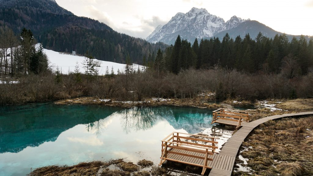 Zelenci Nature Reserve with mountains as a backdrop