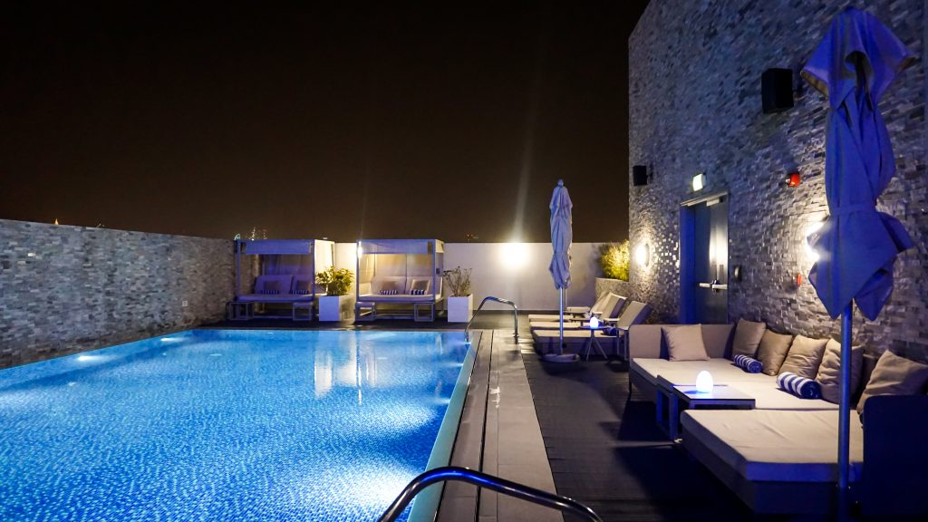 The rooftop pool and some loungers at Novotel Bur Dubai Hotel