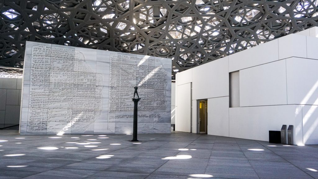 The outdoor spaces of the Louvre Abu Dhabi with a statue in the middle from Dubai Itinerary Day 6