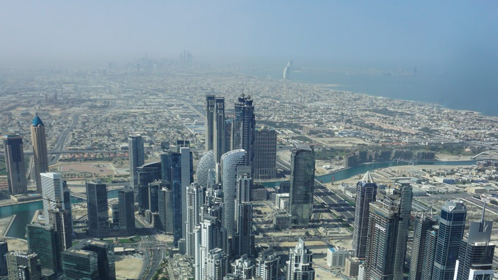 View of Burj Al Arab (in the distance) and other building from Burj Khalifa in Dubai Itinerary Day 2