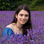 A girl in the middle of a lavender field